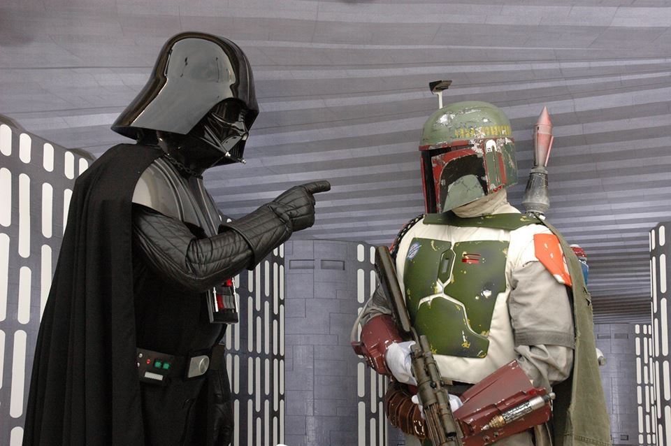 """Darth Vader scolds Boba Fett during a photo opportunity at one of the many charity events.  """"No disintegrations"""" - Darth Vader"""